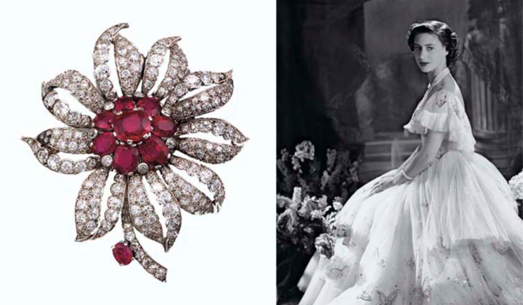 A ruby and diamond flower brooch, by Cartier from the Collection of H.R.H. The Princess Margaret, Countess of Snowdon. Sold for £108,000 on 13 June 2006 at Christie's London. According to Cartier Geneva, this brooch, made by Cartier London in 1948, was originally a clip brooch that had been converted into a pin-fitting brooch — hence the absence of a signature which would originally have been on the top of the clip