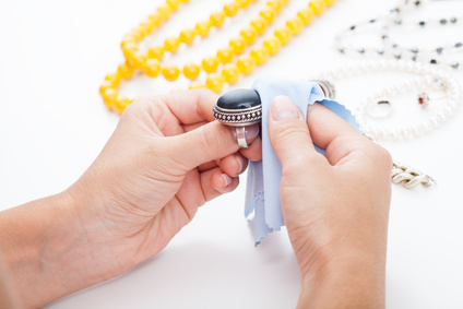 silver identification sydney - silver and gold cleaning hallmarking - Polishing silver jewellery with a cloth