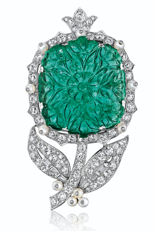 An emerald, pearl and diamond flower brooch, by Cartier, property from the Blair Family Collection. Sold for $487,500 on 7 December 2016 at Christie's in New York. Emeralds are very soft compared to diamonds or sapphires, so carving an emerald, like this flower blossom, without breaking it is a testament to the carver's expertise. This brooch incorporates the influential Indian style of the period with Cartier's exceptional design, workmanship and detailed execution
