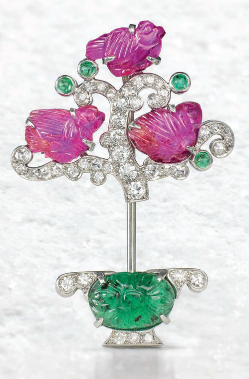 An Art Deco 'Tutti Frutti' jabot pin, by Cartier, circa 1925. Sold for £40,000 on 13 June 2017 at Christie's in London