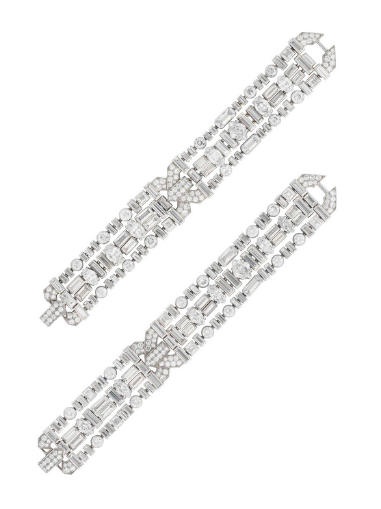 An important pair of Art Deco diamond bracelets, by Cartier, originally from the Collection of Doris Duke. Sold for $991,500 on 26 April 2017 at Christie's in New York. This pair of superb diamond bracelets can be joined together to be worn as a choker. These bracelets exemplify the streamlined quality and exquisite simplicity that Cartier accomplished during the Art Deco era